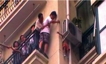 Boy, 3, saved from balcony fall after getting trapped in 7th-floor air con unit