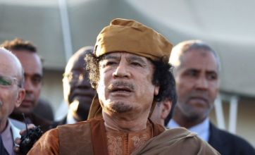 Gaddafi charged with crimes against humanity