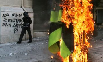 Police use teargas amid violent austerity riots in Athens