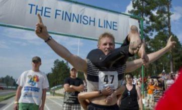 Couple win wife-carrying race for third time