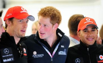 Prince Harry mixes with Jenson Button and Lewis Hamilton at F1 GP