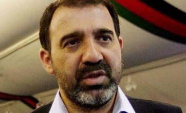Turban bomber kills four at Ahmad Karzai funeral