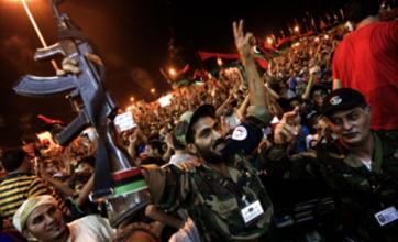 Libyan rebels begin assault on Colonel Gaddafi's Tripoli stronghold