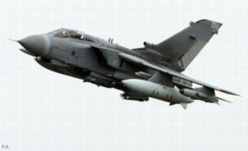 Libya: RAF Tornado jets strike base in Muammar Gaddafi's hometown, Sirte