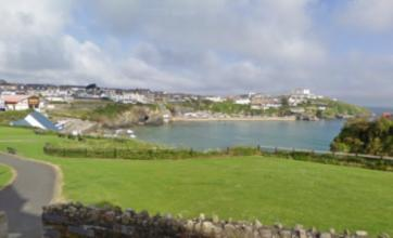 Man, 26, in hospital after falling off 60ft cliff at Towan Beach, Newquay