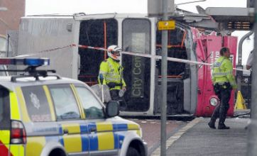 30 passengers hospitalised after Belfast bus mounts curb and upturns