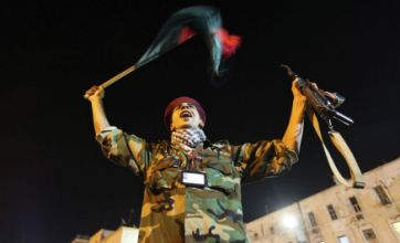 Divided Tripoli parties as 'frizz-head' Gaddafi's regime withers