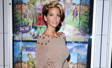 Cheryl Cole 'plans holiday to cheer up Sarah Harding after break-up'