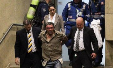 Bomb siege in Sydney ended after police detain father