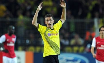 Battling Arsenal floored by late Borussia Dortmund goal