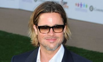 Brad Pitt leaves Angelina Jolie at home for Moneyball premiere