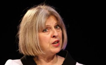Theresa May announces new police powers in the wake of summer riots