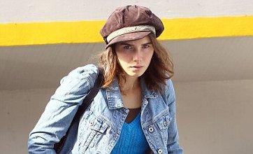 Amanda Knox looks sheepish as she settles back into life in Seattle