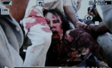 Picture of 'dead Gaddafi' as former Libya leader is shot by fighters