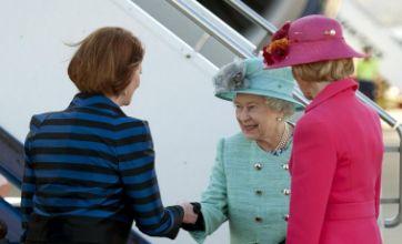 Australian PM Julia Gillard lands in Queen curtsy row