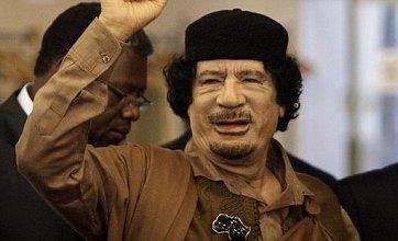 Gaddafi burial at dawn in secret location, government reveals