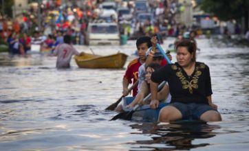 Bangkok tries to divert tides as residents attempt to escape flooding