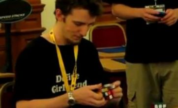 Scottish student holds on to Rubik's Cube speed crown