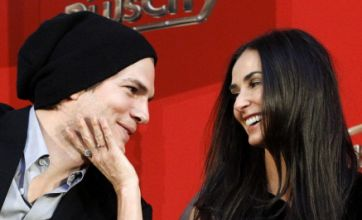 Ashton Kutcher and Demi Moore during happier days (Picture: Reuters)