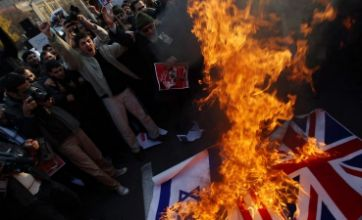 William Hague: Iran will 'pay for' mob attack on British embassy