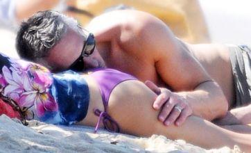 Gary Lineker uses wife Danielle's pert bottom as a pillow during St Barts trip
