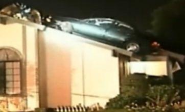 Stolen car lands on house roof, people inside a bit shocked