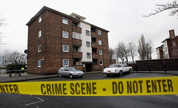 Decapitated man 'was shot first', police reveal, as two men quizzed