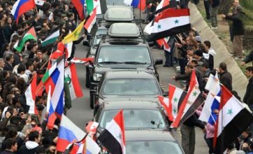 Pro-Assad Syrians in Damascus back Russia's vote for violence