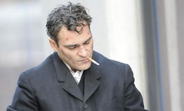 Joaquin Phoenix shows off bloody cuts on his face on set of Low Life