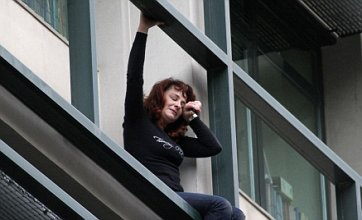 Woman threatens to jump from Athens office amid job loss threat