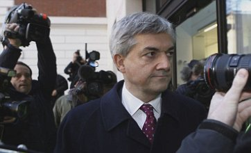 Chris Huhne cuts gloomy figure as he makes first court appearance
