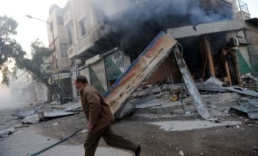 Syrian troops continue Homs shelling as Bashar Assad 'wins 90% approval'