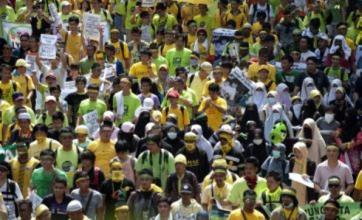 Malaysia police use tear gas and water cannons on Kuala Lumpur protesters