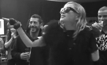 Madonna celebrates MDNA success by chucking cake in manager's face