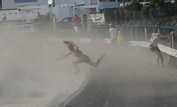 Girl gets blown away by jet plane blast on beach