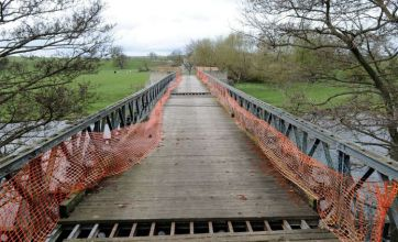 Villagers forced to make 14-mile round trip to collect post after bridge closed