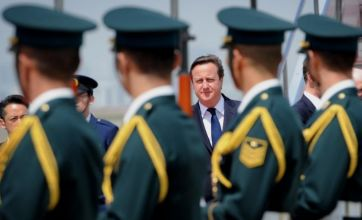 David Cameron 'flies the flag' for Britain in Japan on an Angolan plane