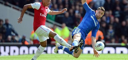 Alex Oxlade-Chamberlain of Arsenal and Gary Cahill of Chelsea