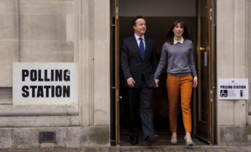 Leaders cast votes as Britain goes to the polls under dreary skies