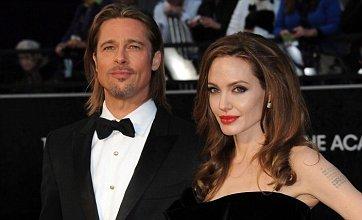 Brad Pitt eyes Stone Roses gig as Angelina Jolie shoots new film in UK