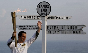 Sailing champion Ben Ainslie kicks off Olympic torch relay at Land's End