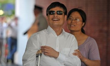 Blind Chinese legal activist Chen Guangcheng arrives in New York