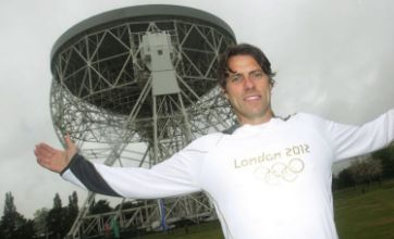'Scared' John Bishop carries Olympic torch up 80m-high observatory in rain