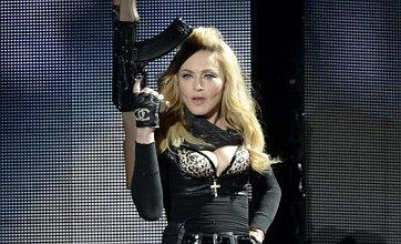 Gun-wielding Madonna causes outrage as MDNA tour kicks off in Israel