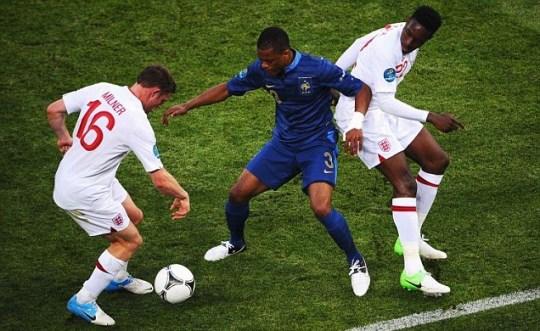 James Milner and Danny Wellbeck of England put Patrice Evra of France under pressure