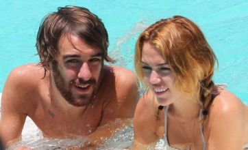 Miley Cyrus' cosy pool pics rock the boat with fiancé Liam Hemsworth