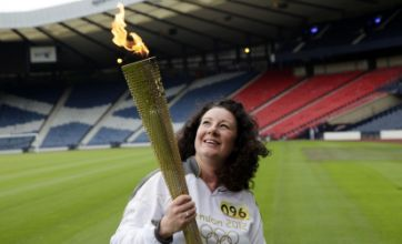 Inspirational charity worker brings the Olympic torch to Hampden Park