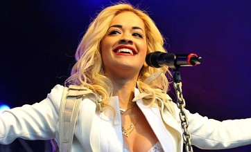 Rita Ora nearly bursts out of her bra as she performs at Lovebox Festival