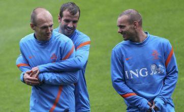 Rafael Van der Vaart tries to pull down Wesley Sneijder's shorts but fails