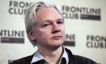 Julian Assange 'subject to arrest' as WikiLeaks founder seeks asylum in Ecuador